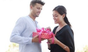 man gives gift to woman