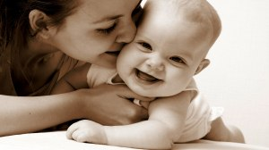 baby laughing mother kissing mom kiss