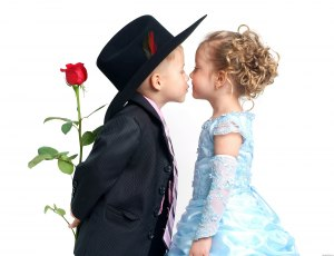 boy with hat kissing girl with prom dress