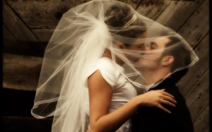 bride and handsome bridegroom kissing luck