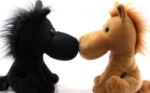 toy horses kissing soft and warm