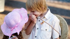 two kids kisses each other